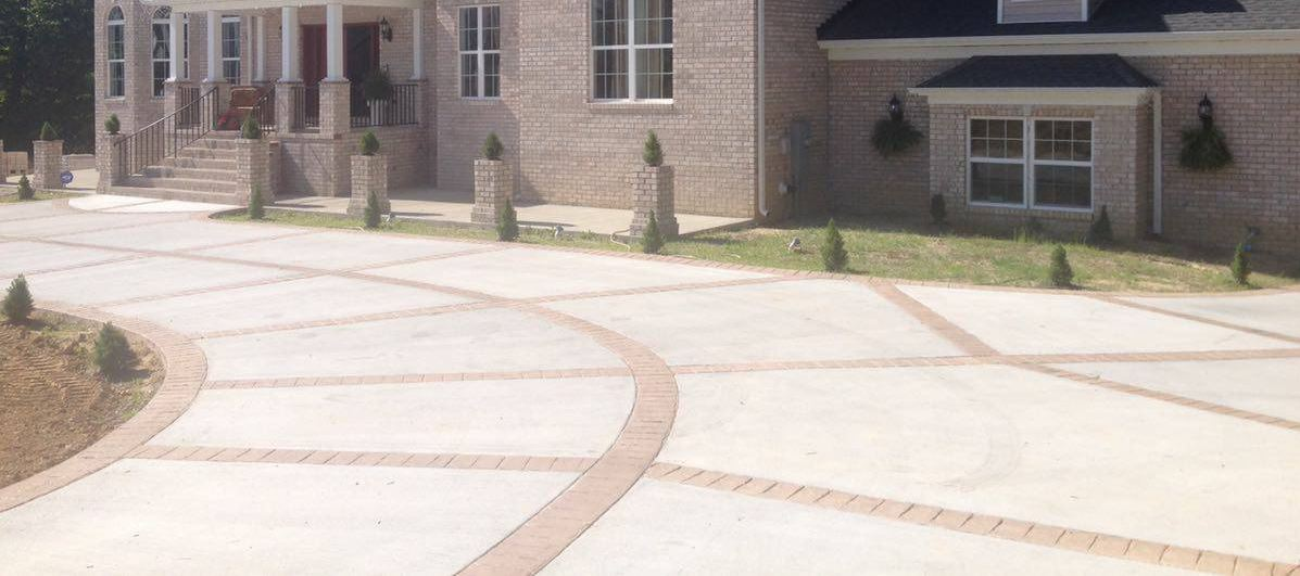 stamped and stained concrete driveway our crew replaced at a chesapeake residence