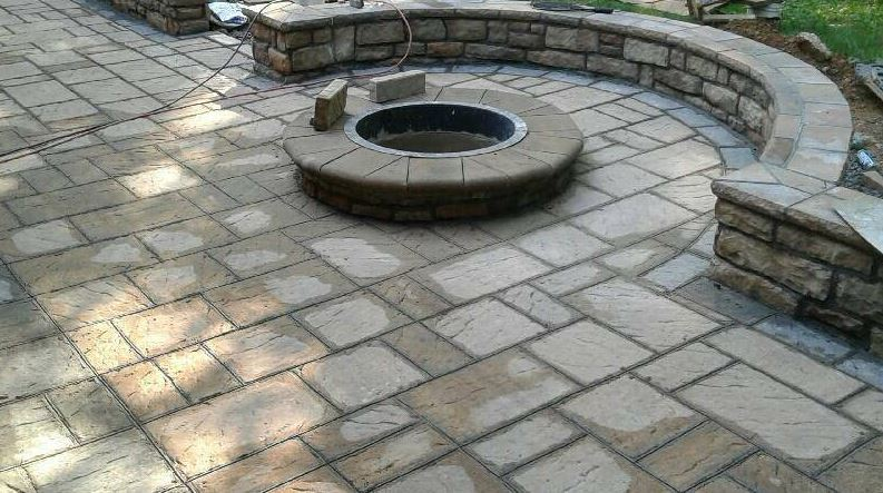 stamped concrete work we've done on a patio with a fire pit in chesapeake, va