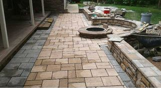 stamped concrete patio with firepit is being installed in va beach